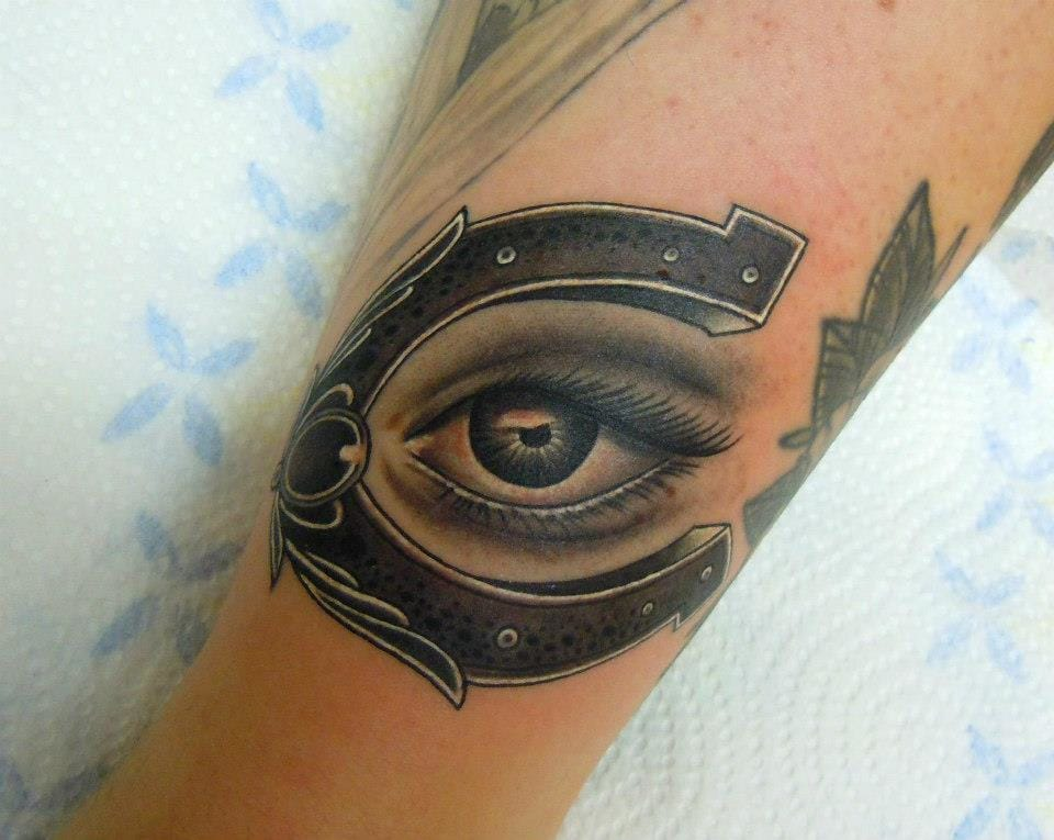 Horseshoe and evil eye by Phatt German.
