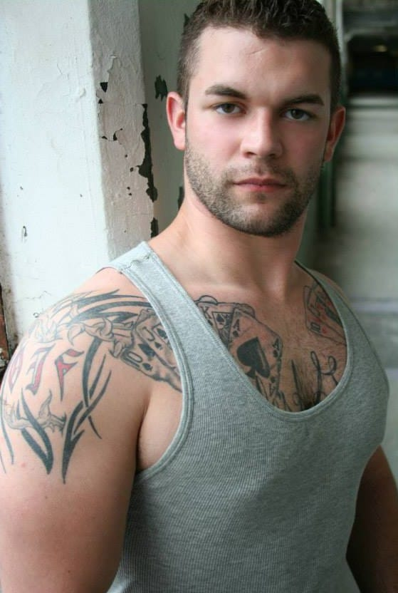 Without the dress he is a tattooed hunk!!