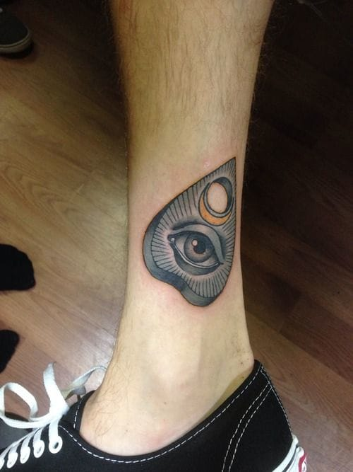 Ouija planchette by Jeremy Hamilton.