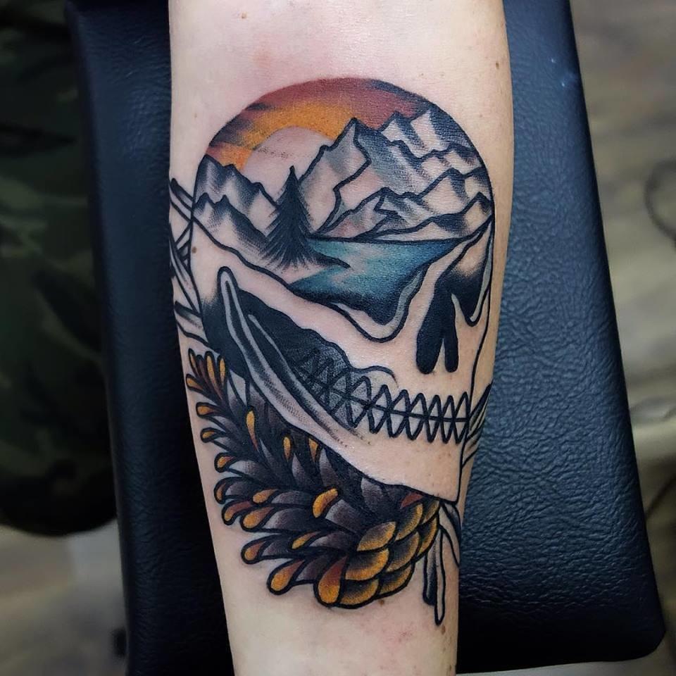 Scenic skull tattoo