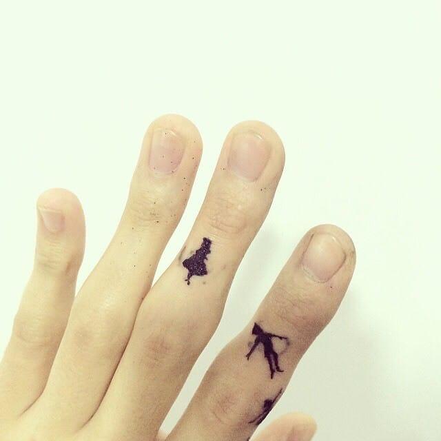 Peter Pan minimalist finger tattoos by hongdam