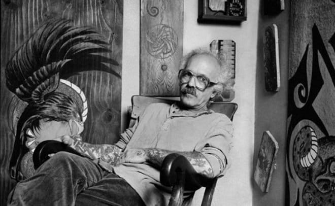 A portrait of De Vita in his studio with some of his works in the background.