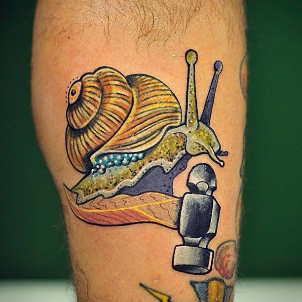 A really awesome hammer tattoo with a snail crawling on it!