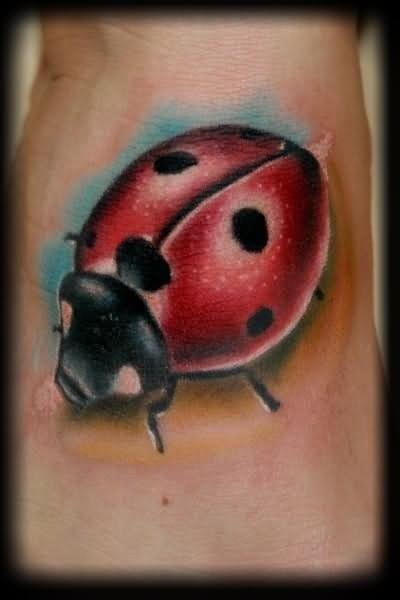 Painterly style lady bug tattoo