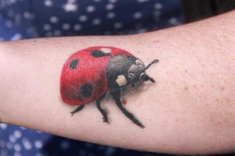 Realistic lady bug tattoo