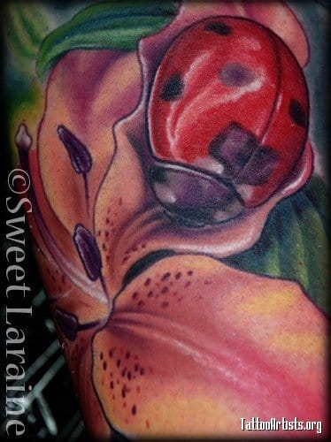 Lady bug on a detail photo of a larger tattoo