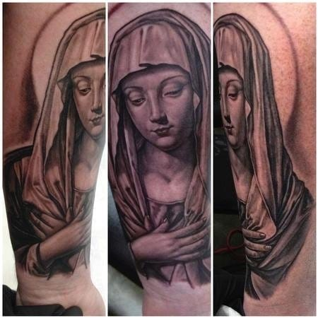 Beautifully solemn Mama Mary tattoo