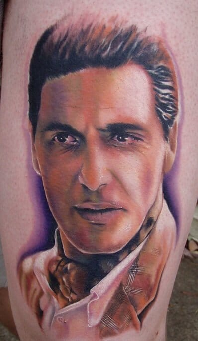 Color portrait tattoo of Al Pacino as Michael Corleone in The Godfather.