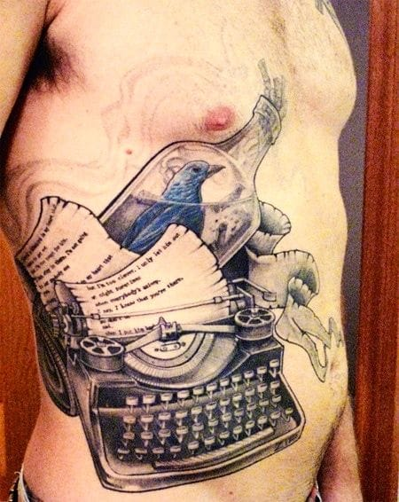 Bukowski's universally relatable message of the bluebird is depicted well in this detailed ribcage tattoo.