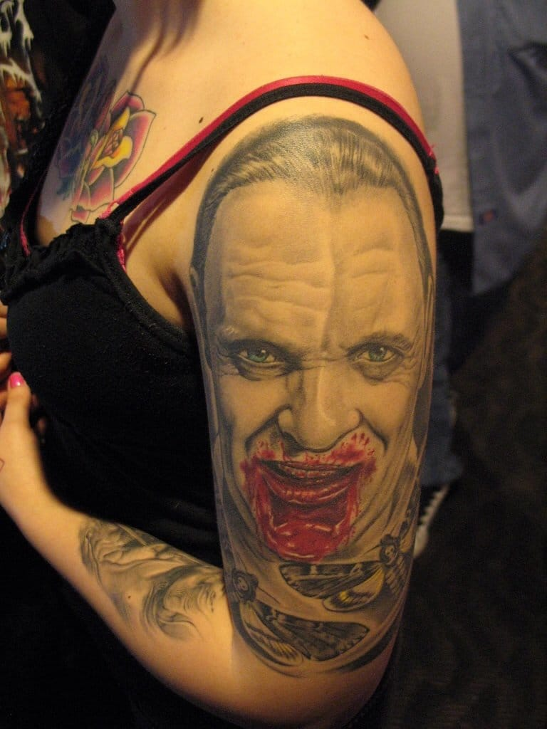 Crazy looking Hannibal lecter tattoo with a bloody mouth!