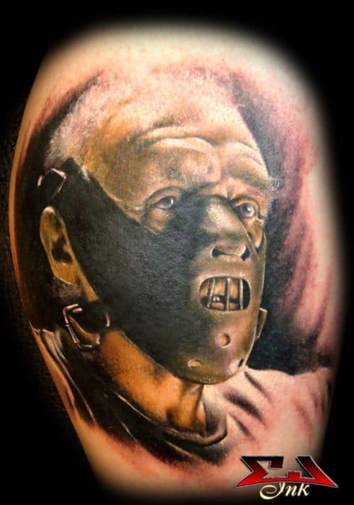 Beautiful colored photo realistic Hannibal tattoo