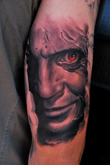 Creepy Hannibal tattoo, check out the red eye!