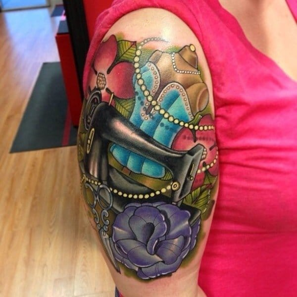 Beautiful half sleeve tattoo showing off a dress and a sewing machine!