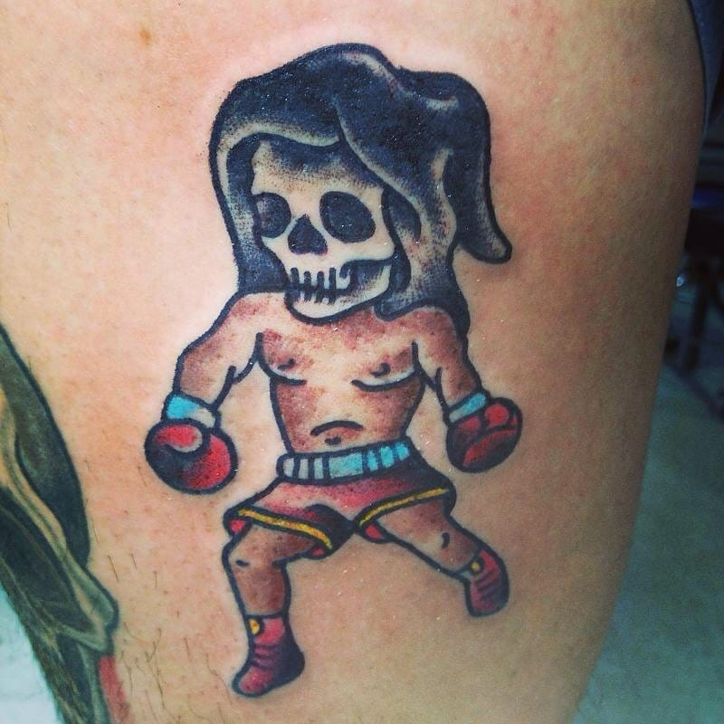 Can't beat it. Fun little reaper boxer traditional tattoo.