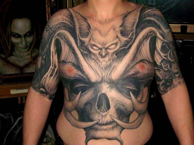 Brutal huge front piece to half sleeve by Paul Booth