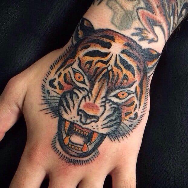 fierce looking hand tattoo, tiger tattoo