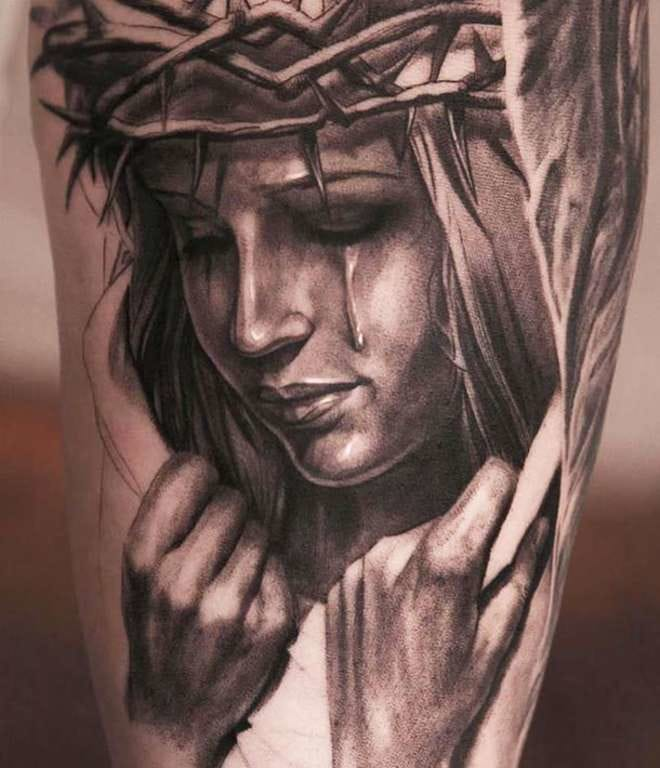 A woman wearing the crown of thorns.