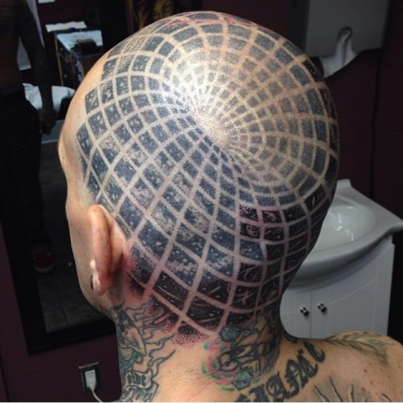 The well-known head tattoo by Corey Ferguson.