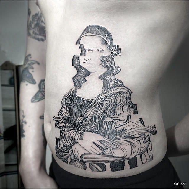 16 Bizarre Glitch Tattoos