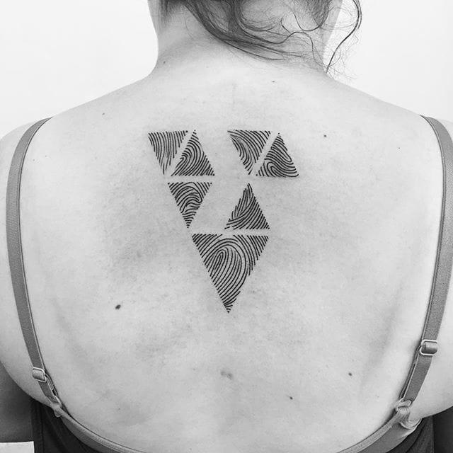 Geometric identity by Finch Tattoo.