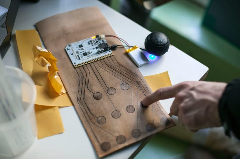Bare conductive electric ink was used to tattoo electric circuits into the leather iPad cover.