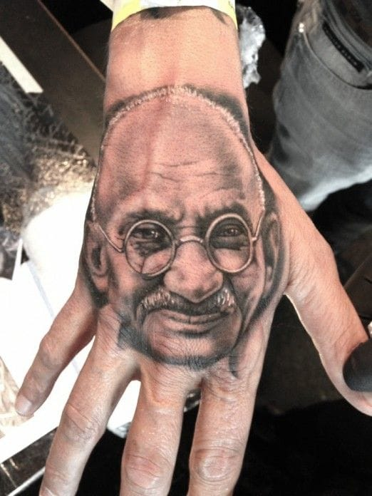 This Gandhi hand tattoo is incredibly real looking