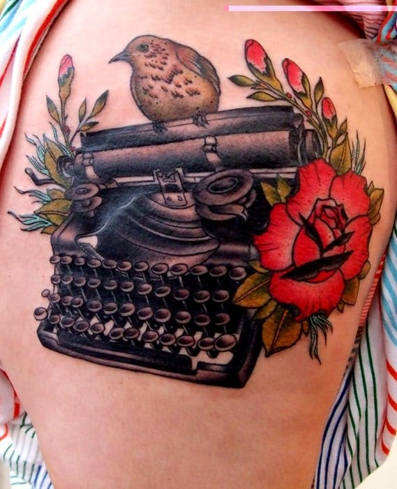 Typewriter with rose and sparrow