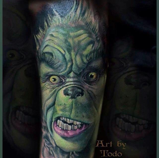 Jim Carrey as The Grinch