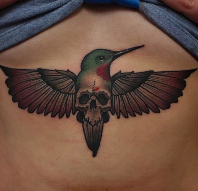 Hummingbird underboob tattoo by Abel Sanchez