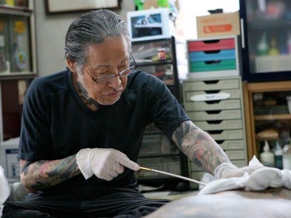 Master Horiyoshi III using the tebori technique on a customer.
