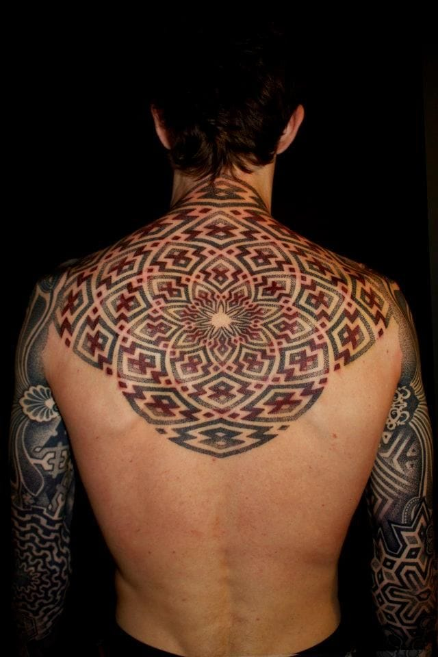 Back tattoo by Vincent Hocquet, arms by Nazareno Tubaro.