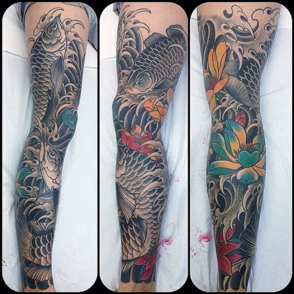 Arowana leg sleeve tattoo done by @krismagnotti
