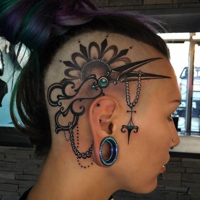 Gorgeous head tattoo by Jessica Wright on tattooed model Poppy Del.