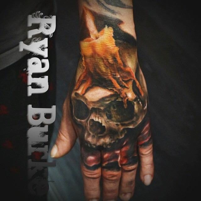 Awesome hand tattoo by Ryan Burke.