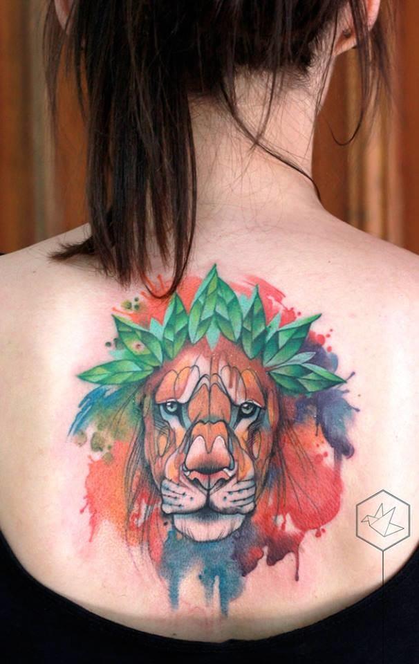 Pretty lion back tattoo.