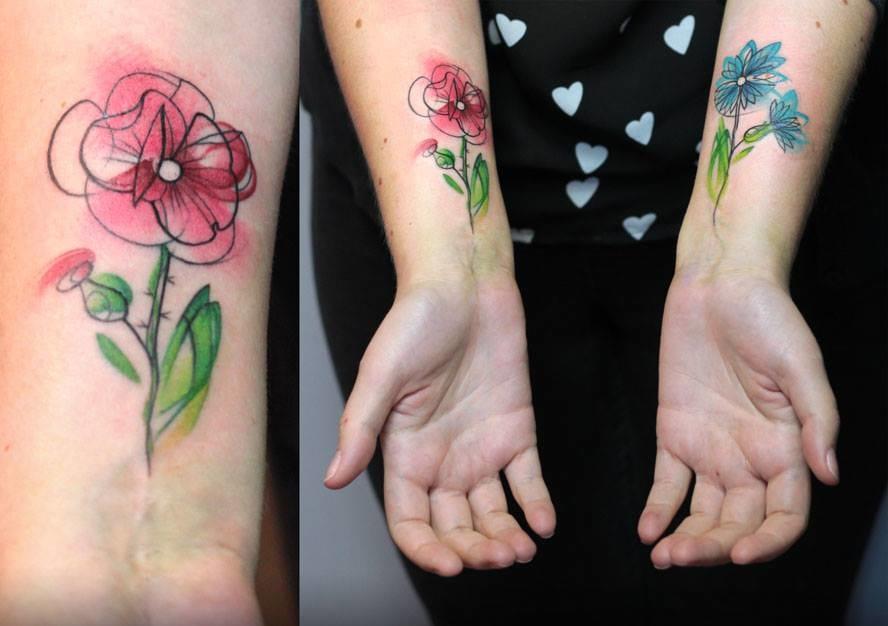 Matching flower tattoos.