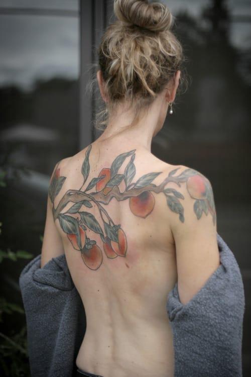 Peach back tattoo.