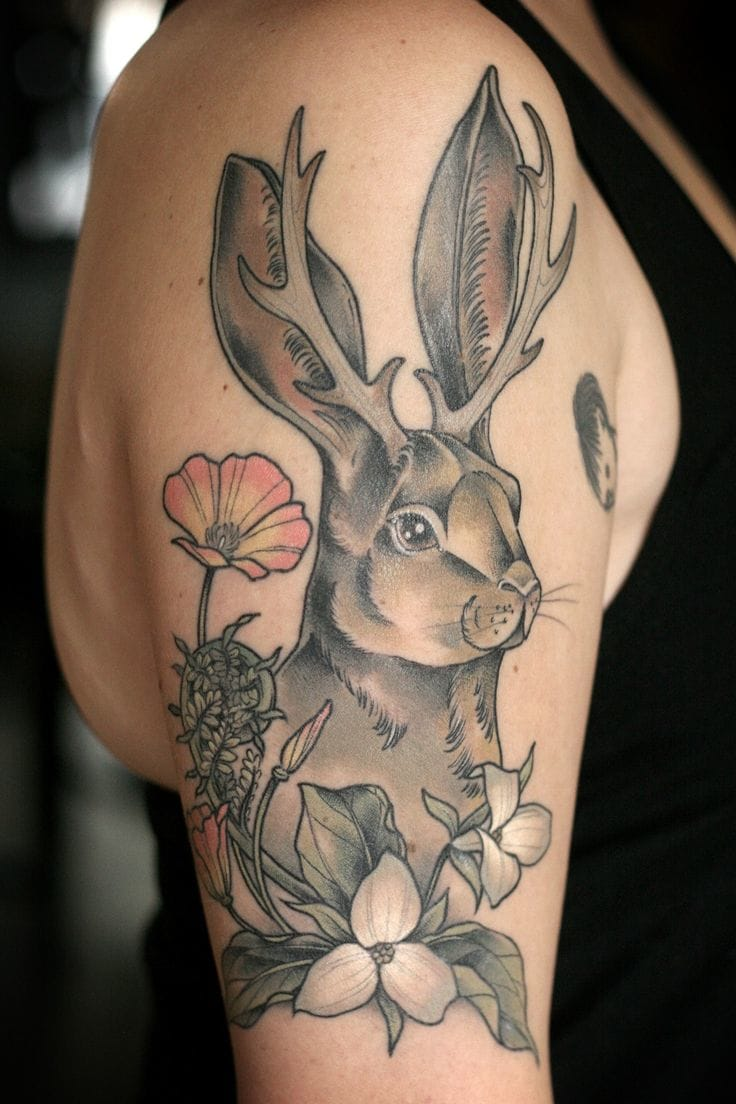 Rabit and flower tattoo.