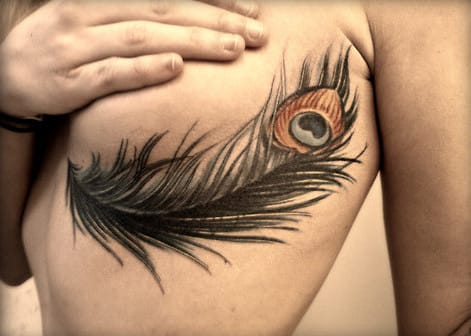 Feather sideboob tattoo, artist unknown.
