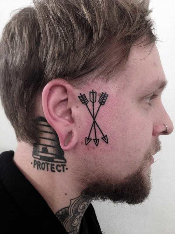 Crossed arrows in blackwork by Philippe Fernandez