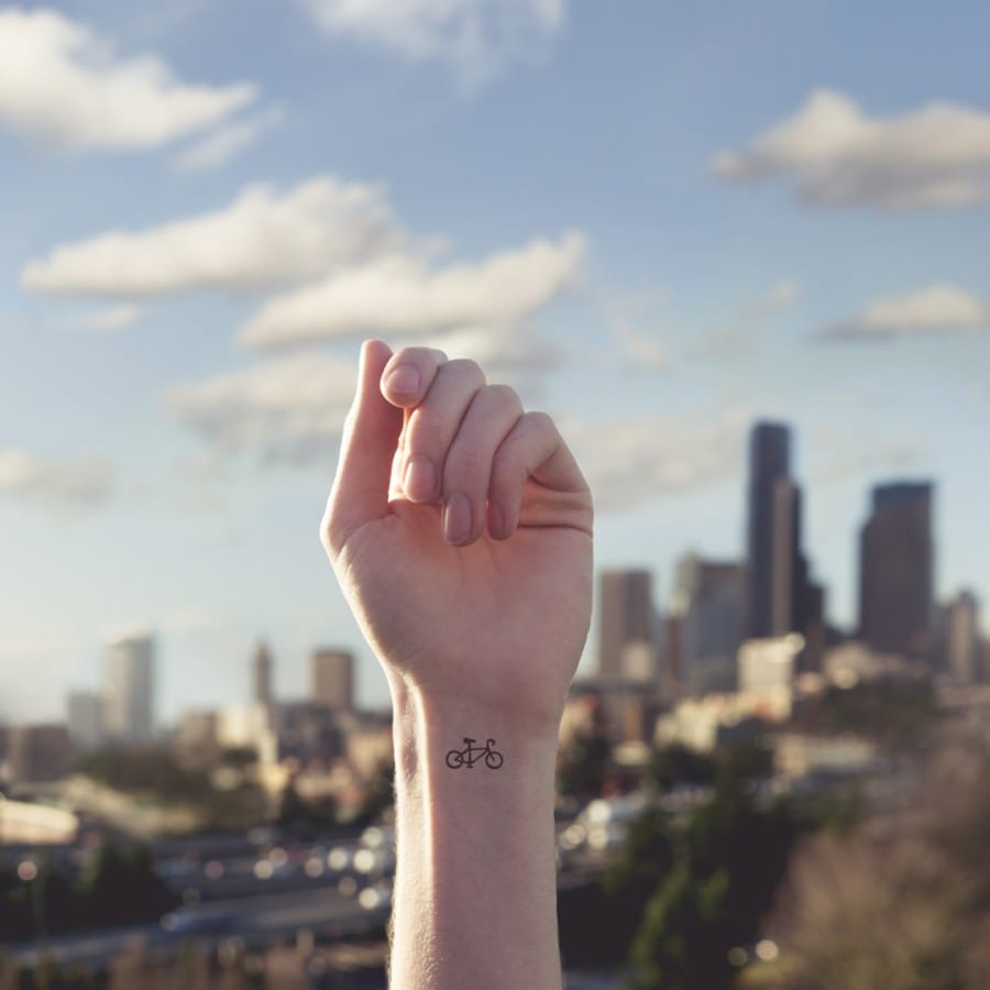 Courtesy of Tott Photo, Little bicycles match for cute wrist tattoos #wrist #wristtattoo #minimalist #bicycle