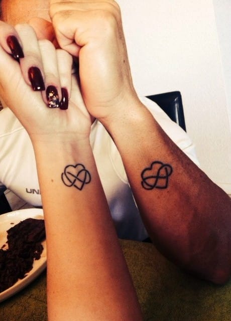 Matching heart/infinity tattoos of Janely Gallego and her dad