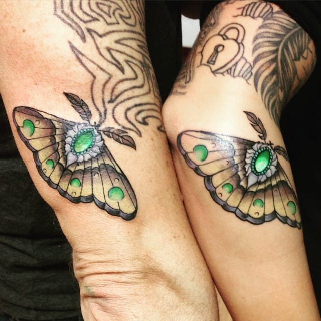 Matching butterfly tattoos by Ronny Camara