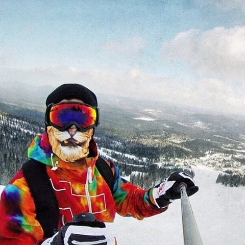 "We'd probably scream ""I'm the king of the world!"" if we had a lion ski mask too on top of a slope. We're going to be so disappointed if we ever find out this guy didn't."