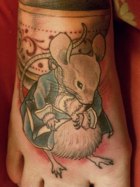 Beautiful mouse tattoo by Ryan Mason!