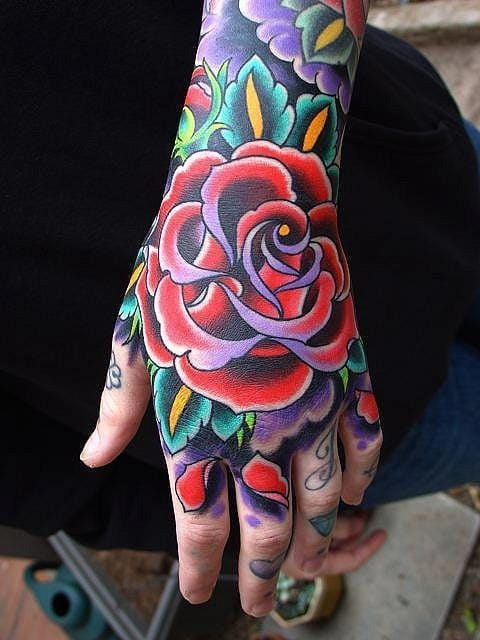 Beautiful color blasted hand tattoo.