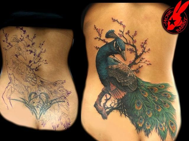 Badly done tribal tattoos can be perfectly covered. Peacock tattoo cover-up. #tribal #tribaltattoos #lines #coverup #peacock
