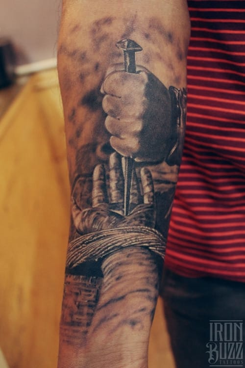 Graphic crucifixion tattoo by Eric Jason Dsouza...