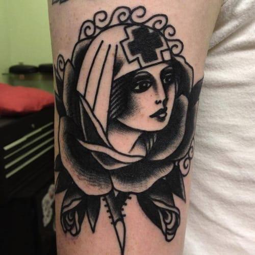 Blackwork Nurse Tattoo by Joe Ellis