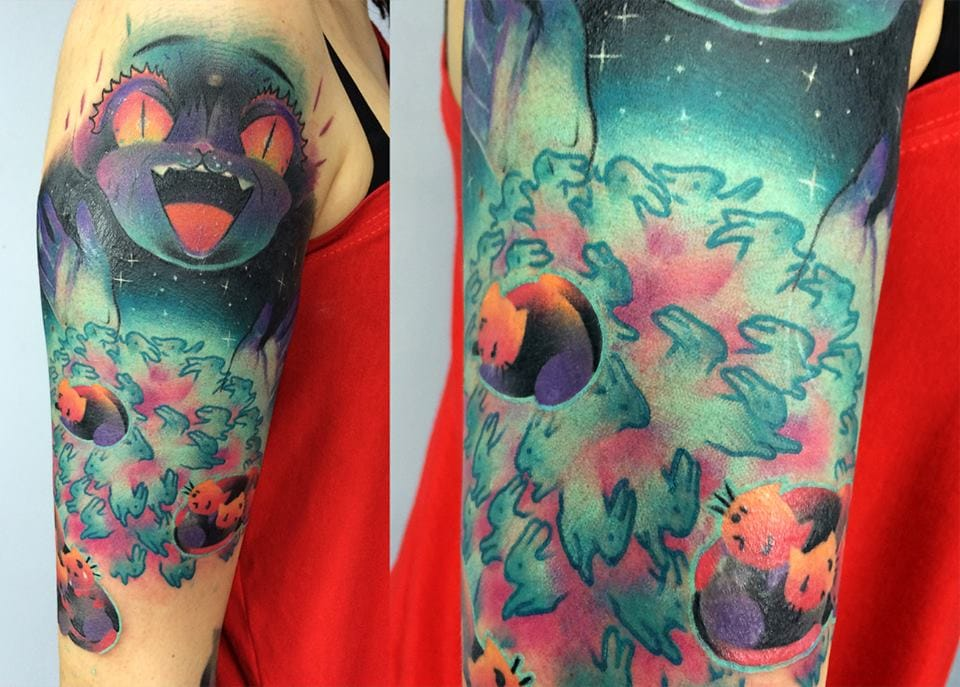 Bunnies and cats mix together to create this lively tattoo! By Giena Todryk.